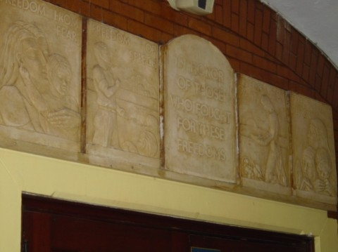 Close up of the Four Freedom Reliefs above the library doorway.